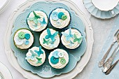 Cupcakes decorated with sugar butterflies and buttons