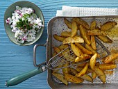 Baked potato wedges with a vegetable quark dip