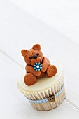 Cupcake decorated with a fondant teddy bear