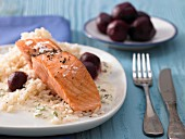 Pan-fried fillets of salmon in creamy mustard sauce with beetroot