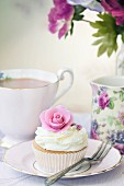 Afternoon tea served with a rose cupcake