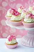 Pink flower cupcakes on a cakestand