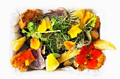 Fish and chips with a flower salad