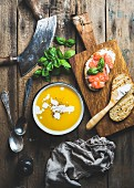 Pumpkin cream soup and salmon, ricotta and basil toasts