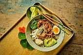 Japanese ramen soup with crispy soft-shell crab, shimeji and avocado