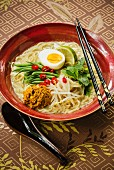 Malaysian curry ramen soup with beansprouts and egg