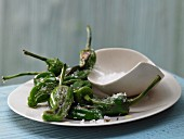Pan-fried mini green peppers in with olive oil and sea salt