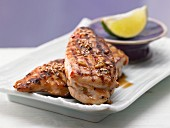 Chicken breast covered in sesame seeds with chilli and honey sauce (Asia)