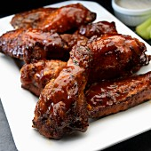 Smoked chicken wings with ranch dressing and celery