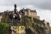 The Royal Scots Greys monument with Edinburgh Castle in Edinburgh Scotland