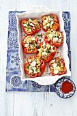 Red peppers filled with lentils, courgette and feta