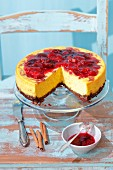 A pumpkin cheesecake with fresh plum jam