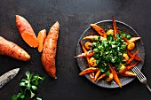 Sweet potato wedges glazed with orange caramel and served with chestnuts and lamb's lettuce