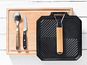 Kitchen utensils: grill pan, spoon and kitchen knife