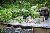 Freshly pickled gherkins in preserving jars on a garden table