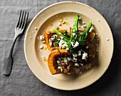 Roasted butternut squash with broccoli, feta and pine nuts