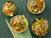Spicy Asian vegetable noodles with pineapple and peanuts