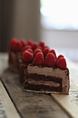 Mini chocolate cream cake with raspberries