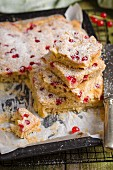 Apple and redcurrant cake on a baking sheet