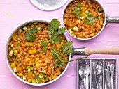 Pan-cooked wheat and vegetable dish with courgette, carrot and yellow pepper