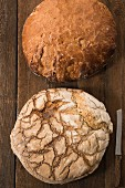 Two large loaves of farmhouse bread and a knife