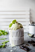 Mint ice cream with chocoöate chips in a white bowl