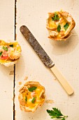 Toast quiches (slices of toast baked in a cupcake tin and fille with ham, egg and cheese)