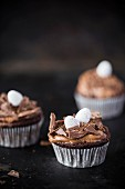 Chocolate cupcakes with sugar eggs