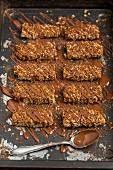 Homemade flapjacks coated with chocolate