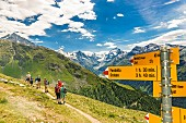 Lots of signposts on a hiking trail in Valais, Switzerland