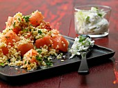 Bulgur wheat and melon salad with mint tzatziki