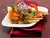 A prawn salad with melon wedges