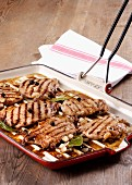 Grilled fillets of pork in vinegar sauce