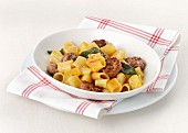 Mezze maniche pasta with sausage and sage