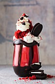 A red velvet freak shake with Oreo biscuits