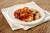 Pork escalopes with olive and tomato sauce