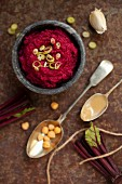 Beetroot hummus with spring onions