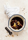 Spiced masali chai syrup in a saucepan