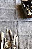 Antique cutlery on a fabric surface