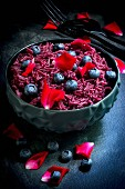 Vegan blueberry rice with rose petals