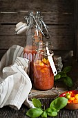 Gazpacho with tomato and peppers in swing-top bottles