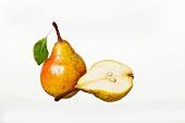 Whole Williams pear and half a pear