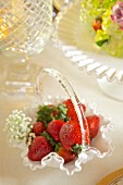 Fresh strawberries in an elegant glass basket