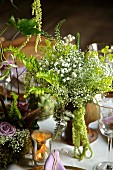 Bouquet with gypsophila on set table