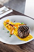 Spicy fillet of beef with carrots and plum jus