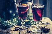 Two glasses of mulled wine with cloves, cinnamon and star anise for Christmas