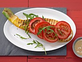 Grilled zucchini with tomatoes, sesame paste and arugula