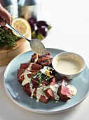 Grilled beef medallions with pink peppercorns, Cognac and bay leaf sauce