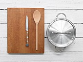 Knife, wooden spoon and saucepan