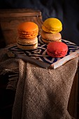 French macarons on a wooden table with sackcloth